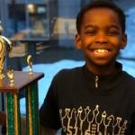 八歲小難民成紐約州象棋冠軍 獲善款助其餘移民
